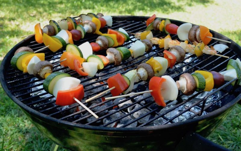Vegetable skewers (tomato, mushrooms, onion, pepper) on a barbeque